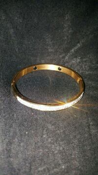 gold-colored bracelet with silver-colored ring Silver Spring, 20902