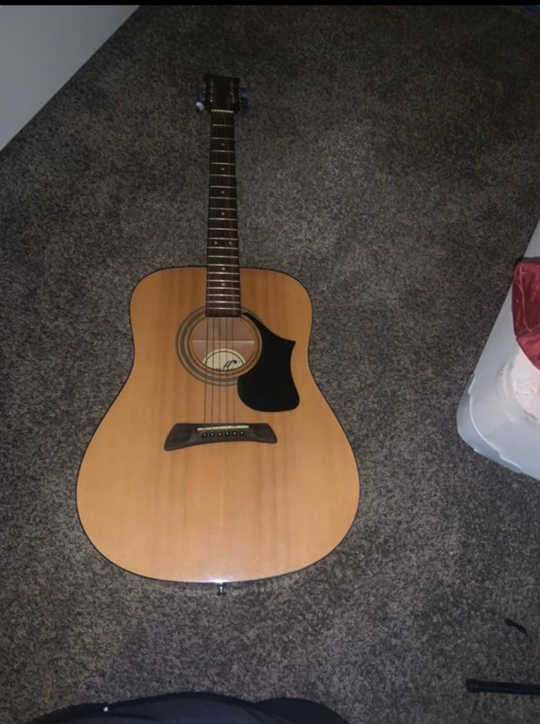 Photo First Act Acoustic Guitar!