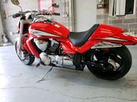 red and black touring motorcycle Bowie, 20715
