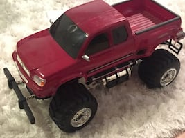 Red and black plastic truck toy