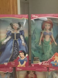 two Disney Ariel and Snow White doll packages
