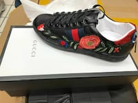 unpaired black, red, and green flower print Gucci sneakers with box