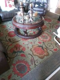 round brown wooden framed glass top coffee table San Diego, 92139