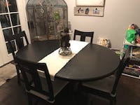 round brown wooden table with four chairs dining set Anaheim, 92806