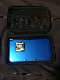 blue Nintendo DS with game cartridge