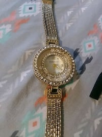 round gold analog watch with gold link bracelet New Haven, 06511