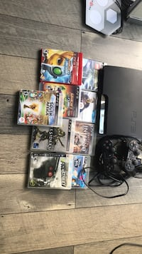 Sony ps3 slim console with controller and game cases 2310 mi