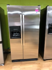 Whirlpool stainless stainless side by side refrigerator  Woodbridge, 22191