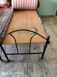 Single iron cot with mattress and pillows