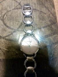 round silver analog watch with silver link bracelet 40 km
