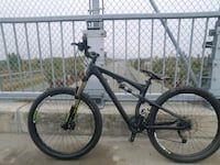 black and gray full-suspension bike Candiac, J5R 6X1