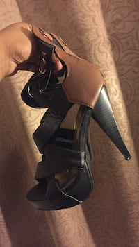 Pair of black leather open-toe heeled sandals Davenport, 52804