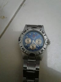 round silver-colored Rolex chronograph watch with