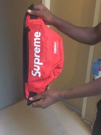 red and white Supreme backpack