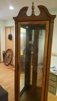 Solid oak glass and wood corner cabinet Waterford Township, 48329