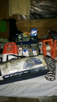 several tent bags and fishing reels colmen lantern Charlotte, 28214