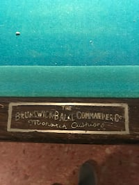 Brunswick Pool Table w/ pool sticks,light and string of beads for stra