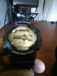 round black Casio G-Shock digital watch