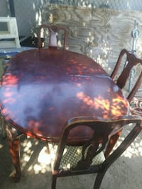 round brown wooden table with four chairs dining set Bakersfield, 93307