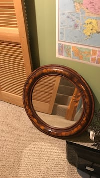 round brown wooden framed mirror. Herndon, 20171