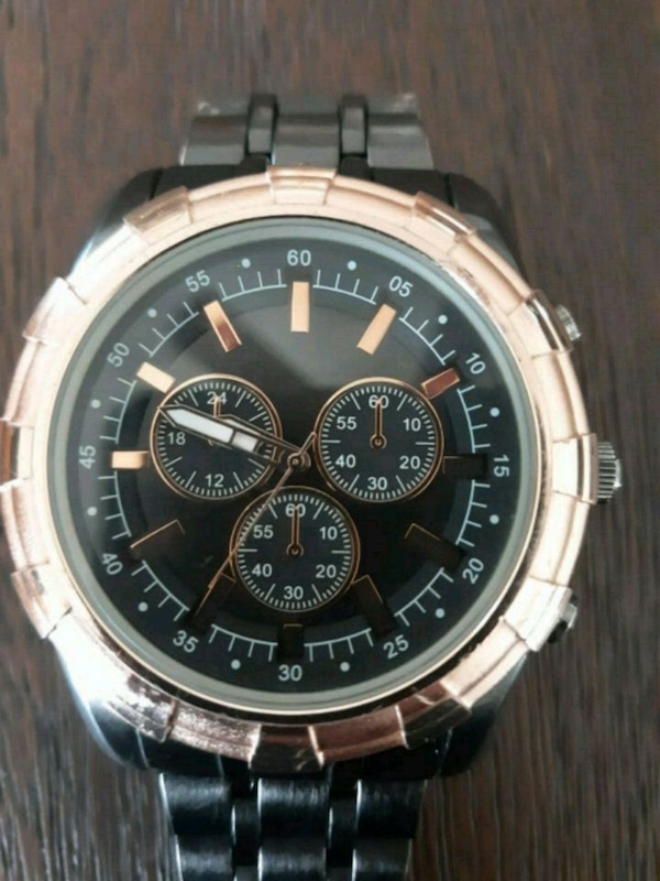 round silver-colored chronograph watch with link b