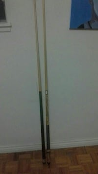 two brown cue sticks