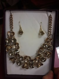 gold and silver beaded necklace and earrings