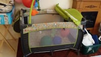 baby's green and gray travel cot Toronto, M1L 4J9