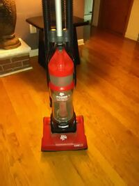 red and black Dirt Devil upright vacuum cleaner Ecorse, 48229