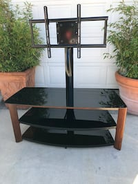 Glass 3-tier TV stand with rotating TV mounting bracket Garden Grove, 92841