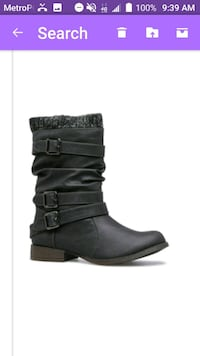 pair of black leather boots Buffalo, 14223