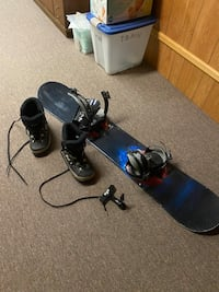 Snowboard, boots and wall holder