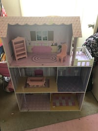brown and pink 3-storey dollhouse 58 mi