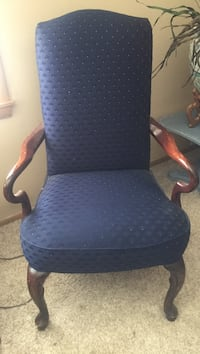 Blue and white padded armchair