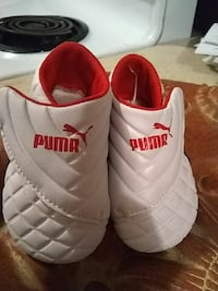 pair of baby's quilted white-and-red leather velcro shoes