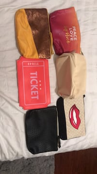 three red, black, and white Supreme bags 1407 mi