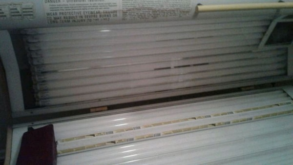 white and black tanning bed