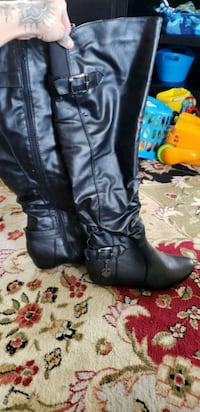 pair of black leather knee-high boots Albuquerque, 87120