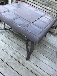 Table patio with tiles and a center cooler