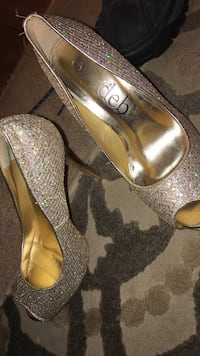 pair of silver peep-toe pumps