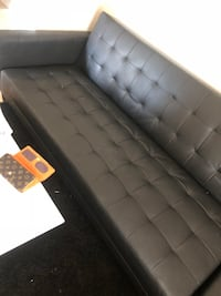 Tufted black leather sectional sofa Laval, H7N