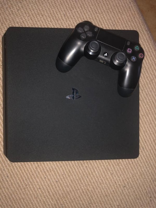 PS4 slim with 6 games  1f59c106-5c30-4cbc-bfa6-ce08a27be0b3
