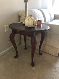 round brown wooden pedestal table null