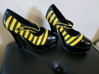 pair of black-and-yellow open toe pumps Reno