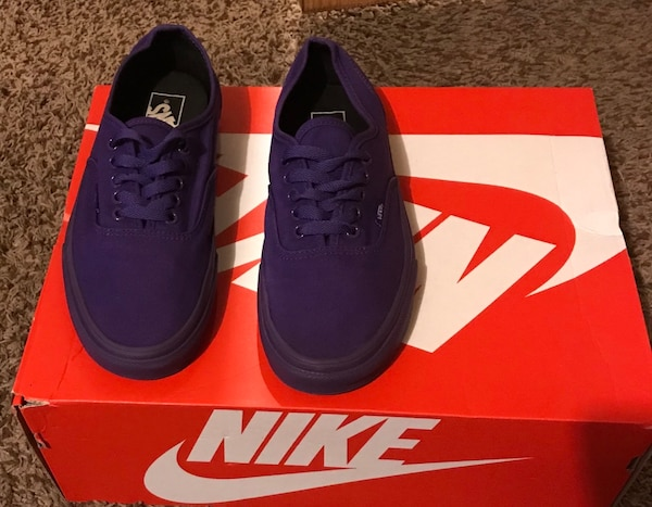 pair of purple Vans Authentic
