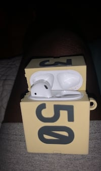 Airpod (left) with yeezy box case