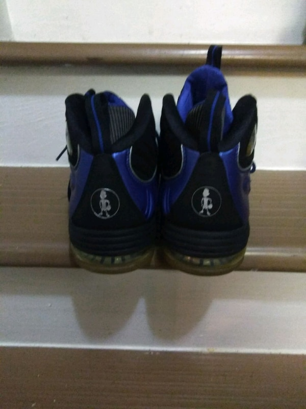 pair of black-and-blue Nike basketball shoes 0a643d8d-0159-4dd2-b2fc-25320128fb73