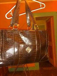 brown and black leather tote bag 963 mi
