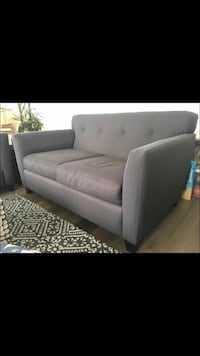 Gray love seat sofa couch