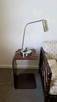C shaped bedside table and reading lamp